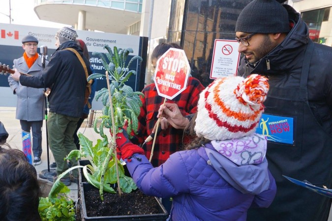A protest against the '4 and 4 rule' outside of Citizenship and Immigration Canada in Toronto on March 29th. Protesters planted food to symbolize migrant workers being rooted in our communities.  Photo: Murray Lumley Facebook.