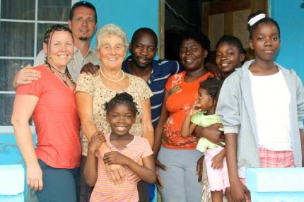 Jenn, Ekk and Barnhild Pfenning visiting Desmond, a long-time employee with Pfenning's Organic Farm, and his family in Jamaica in 2012. Photo: Pfenning's Organic Farm.