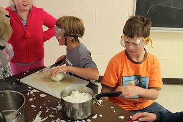 Evergreen Heights students chop onions with full eye protection! Credit: Kelli Ebbs.