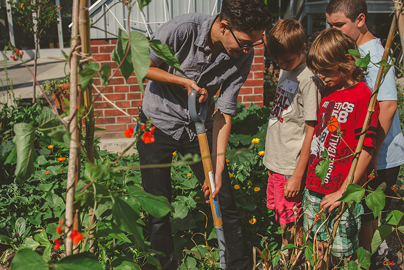 Hands-on lessons about growing food in The Stop CFC's garden. Credit: The Stop CFC.